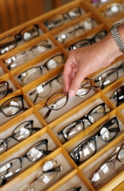 person selecting frames for glasses